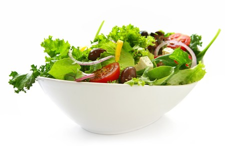 Healthy green salad, in stylish white bowl.  Isolated on white. Banco de Imagens