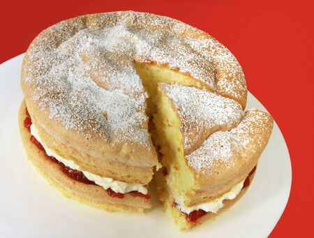 strawberry jam: Home-baked sponge cake filled with fresh whipped cream and strawberry jam, and topped with powdered sugar.