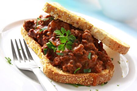 minced beef: Sandwich of savory ground beef on toasted wholewheat bread.  A delicious variety of a Sloppy Joe.