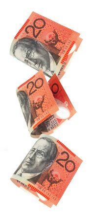 Australian twenty dollar notes falling, isolated on white.