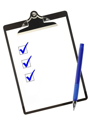 Checklist on clipboard, with blue ticks and ballpoint pen. photo