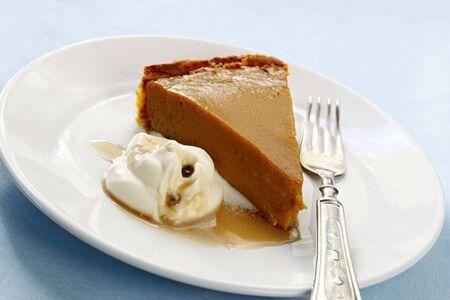 Home-baked pumpkin, with whipped fresh cream and maple syrup. photo