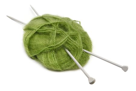 knitting needles: Ball of green mohair knitting wool or yarn, with silver knitting needles.