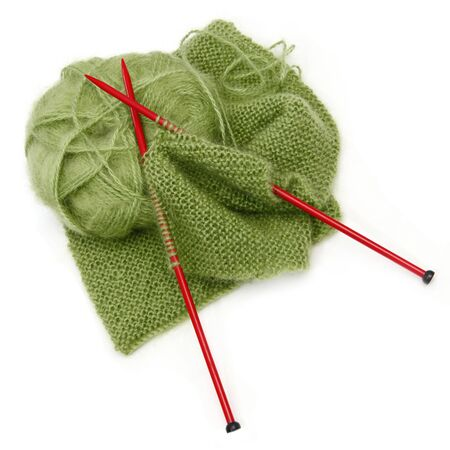 Knitting yarn and red needles, with scarf inprogress.  Green mohair wool. Stock Photo - 4597189