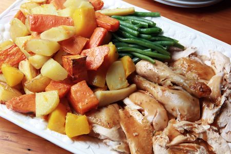 Platter of roast chicken with gravy, roasted vegetables and beans, ready for serving. Stock Photo - 4597188