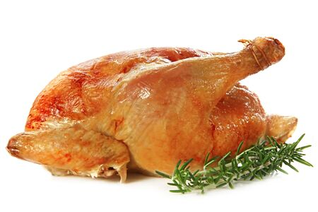 Roast chicken, isolated on white, with fresh rosemary sprigs.