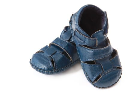 Little blue leather baby shoes or booties, isolated on white.  Very cute! photo