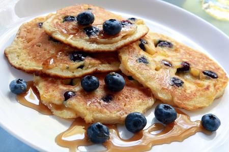 absolutely: Blueberry pancakes with maple syrup.  Absolutely delicious! Stock Photo