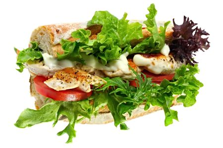 Baguette filled with grilled chicken, tomato, lettuce, and mayonaisse.  Isolated on white. Stock Photo