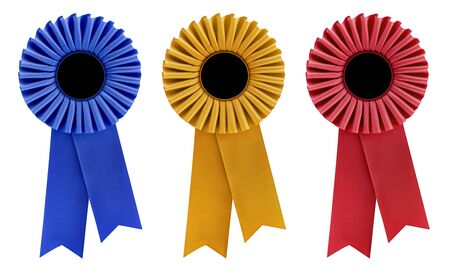 Blue, gold and red rosettes, with copy space, isolated on white. photo