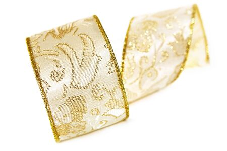 Golden brocade ribbon, in soft focus, on white background.  Focus on dove. photo