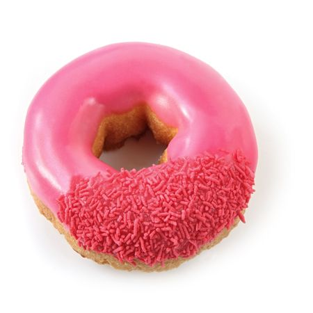 hundreds and thousands: Pink iced donut with sprinkles, isolated on white with shadow.