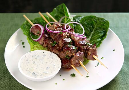 tzatziki: Lamb kebabs with tzatziki ~ cucumber yoghurt. Stock Photo