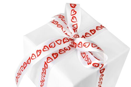 Gift box with white satin ribbon with red hearts.  A loving gift. photo