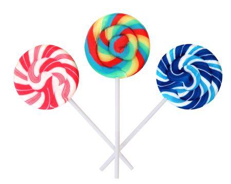 paletas de caramelo: Tres colores pirul�s, aislado en blanco. Foto de archivo