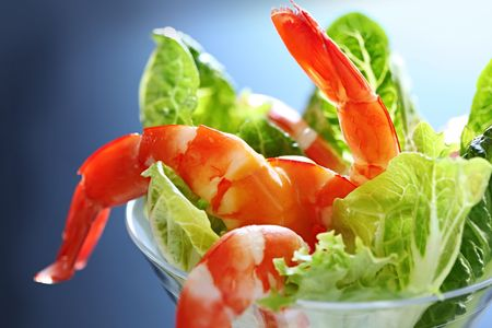 Shrimp cocktail with baby cos lettuce and creamy seafood sauce, in a martini glass.  Lovely king prawns.