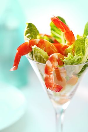 shrimp cocktail: Shrimp cocktail in a martini glass, with cos lettuce and seafood cocktail sauce. Stock Photo