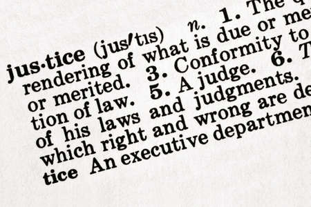 lawful: Dictionary definition of the word justice, in sepia tone.