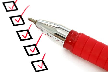 checklist: Red ballpoint pen with ticks in checkboxes.  Good paper texture, close-up view.