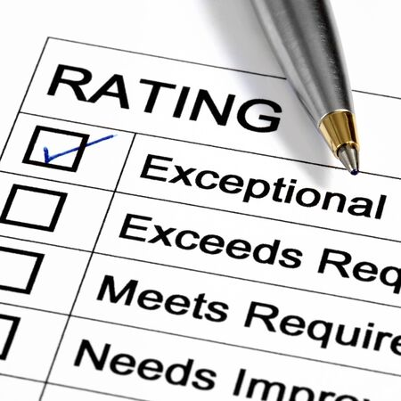 marked: Exceptional Rating marked with ballpoint pen. Stock Photo
