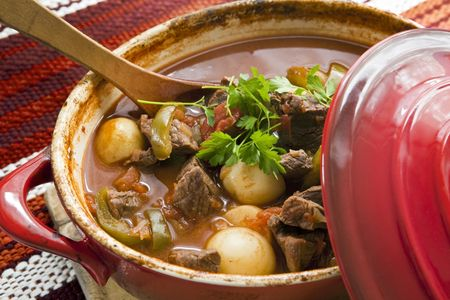 goulash: Crock pot of beef goulash, ready to serve.  Lovely warming food. Stock Photo
