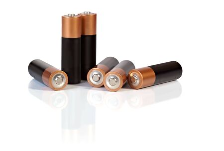 aa: AA batteries, casting reflection on white surface.