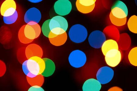 christmas lights background: Colorful bokeh ~ defocussed Christmas fairy lights.