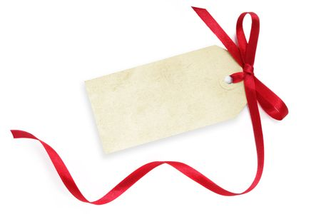 satin ribbon: Blank grunge gift tag tied with a bow of red satin ribbon.  Isolated on white, with soft shadow.