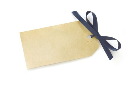 Blank gift tag tied with blue satin ribbon bow.  Casting soft shadow on white surface. Stock Photo - 5055813