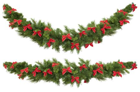 artificial lights: Christmas garlands decorated with red velvet bows, isolated on white.  One garland is straight, and the other curved.
