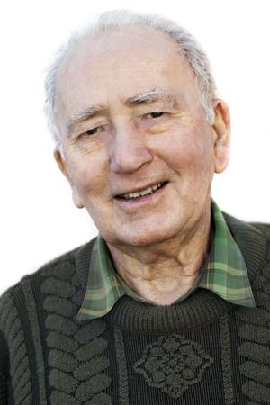 old photographs: Portrait of a smiling senior man, over white background.  A fit, healthy retiree in his 80s.