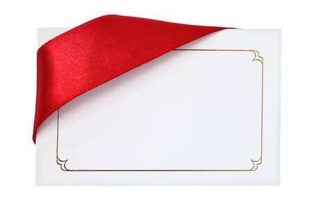 corner ribbon: Ornate gift card with red satin ribbon draped over one corner.  Use card or ribbon for copy-space.