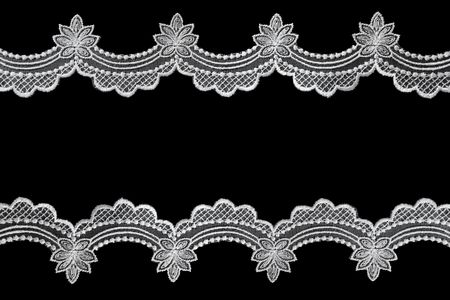 scalloped: White scalloped lace over black background.  A lovely delicate border. Stock Photo