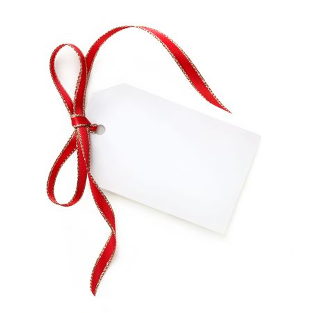 gift tag: Blank white gift tag with red and gold ribbon bow.  Isolated on white with soft shadow. Stock Photo