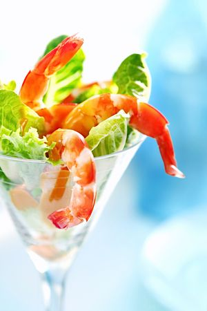 martini glass: Shrimp cocktail in a martini glass, with cos lettuce and seafood cocktail sauce. Stock Photo