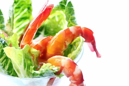 Shrimp cocktail in a martini glass, with kos lettuce and a zingy seafood sauce. photo