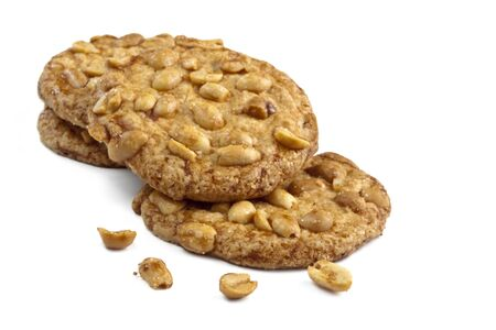snacking: Peanut cookies over a white background.  Delicious home-baked snacking.