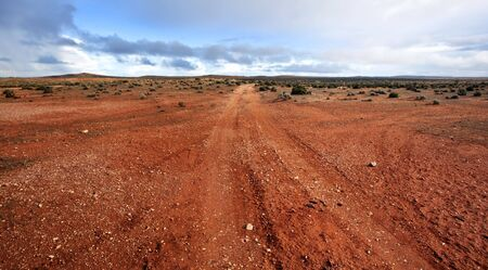 Track in the Australian outback, outside Broken Hill in western New South Wales.  A storm was brewing. photo