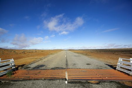 cattle guard: Cattle grid or guard, on road in the Australian outback.  West of Broken Hill, New South Wales. Stock Photo