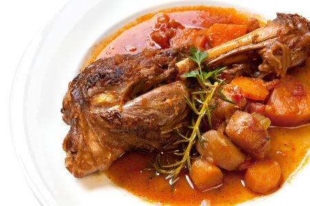 Slow-cooked lamb shank with vegetables.  Delicious, homely goodness. photo