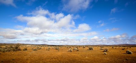 australian: Panorama of the red desert of the Australian outback, with brilliant blue sky.  Western New South Wales.