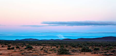 outback australia: Sunset over desert landscape.  Outback Australia, west of Broken Hill.
