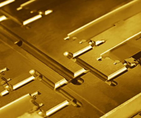 Metallic abstract - core of injection moulding die, in golden tone.