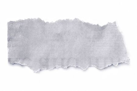 Torn newspaper, isolated on white with natural soft shadow. photo