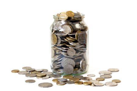 Overflowing jar of Australian coins, isolated on white. photo