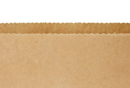 brown paper: Top serrated edges of an open brown paper bag, over white background. Stock Photo