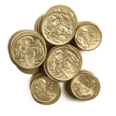 Stacks of Australian one dollar and two dollar coins, isolated on white. photo