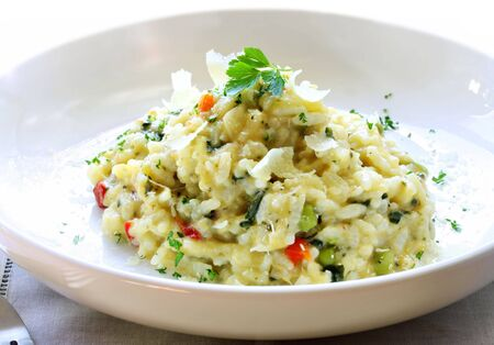 topped: Delicious risotto, topped with shaved parmesan cheese and parsley.