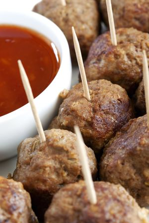 A platter of tasty meatballs, with a savory dipping sauce.  Perfect party food or appetiser.  Selective focus. photo