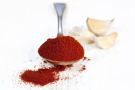 spoonful: Spoonful of paprika, with cloves of garlic.  Very shallow DOF.  Perfect for a traditional Hungarian goulash.